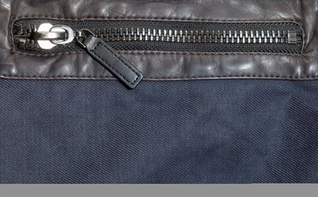 Leather Pocket With Zipper On Blue Jeans Jacket