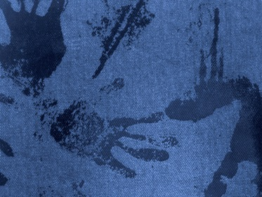 Blue Fabric With Black Paint Hand Traces