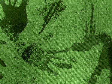 Green Fabric With Black Paint Hand Traces