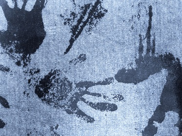 Light Blue Fabric With Black Grungy Paint Hand Traces