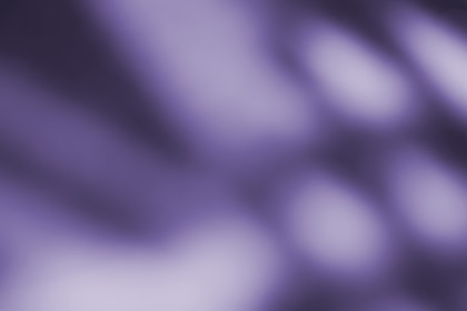 Abstract Purple Blurred Shapes Background