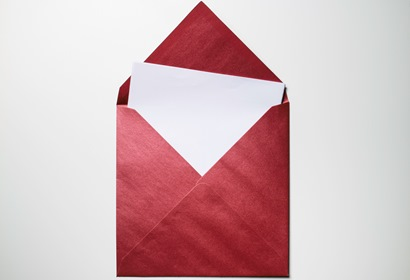 Opened Red Envelope With White Paper Inside