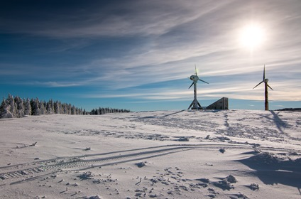 Snow Winter Landscape With Wind Power Generators