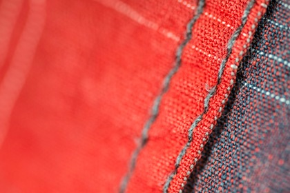 Red Fabric Background Bokeh Stitched