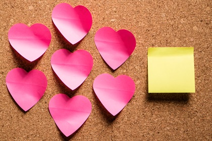 Pink Heart Shaped Paper Notes On Corkboard