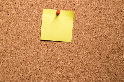 Yellow Paper Note On Cork Board