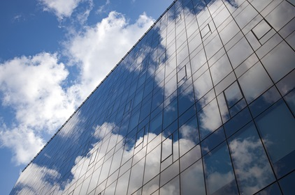 Blue Sky Clouds Reflected In Glass Business Building